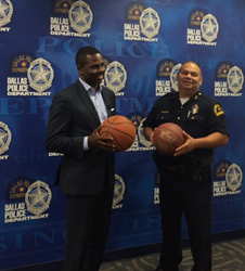 "Pastor Richie Butler of St. Paul's United Methodist Church and first asst. chief Charles Cato of the Dallas Police Department strategize about the ""Together We Ball"" basketball game on Aug. 9, 2015"
