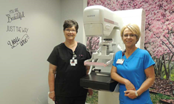 Mammography Technologists LeAnn Fryer, R.T. (R) and  Lynn Foster, R.T. (R) at MRHS standing beside the Fujifilm Cristalle
