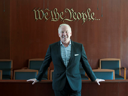 Attorney West Seegmiller poses near the jury box in a mock courtroom in his Newport Beach office.