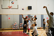 Julius Erving shoots hoops with the kids after they all received an ABA style basketball from Grab A Ball & Play