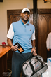 Alonzo Mourning walks through the Erving Gifting Suite holding a signature Vessel Erving Carry Bag.