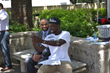 Radio One's KG Smooth (right) emceed the Road Warriors Festival and snapped selfies with patrons, including H-GAC Assistant Director of Transportation Planning, Eulois Cleckley (left)