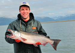 Copper River fisherman with coho salmon.