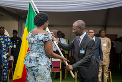 Mercy Ships volunteer Emmanuel Essah, from Benin presented the flag of his country to the First Lady of Benin upon arrival when she visited the floating hospital.