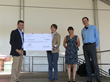 Bryan Granger, C&S Charities secretary (left), presented a ceremonial check to representatives of Feeding America, one of six nonprofit organizations honored at the Tee Up for Kids™ Golf Outing.