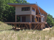 Great craft coupled with quality materials and efficient envelopes characterize modern homes such as this contemporary timber frame in Michigan.