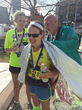 Leaning Ally College Success Program Mentor Coordinator Abigail Lanier after finishing the Boston Marathon