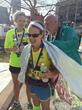Leaning Ally College Success Program Mentor Coordinator Abigail Lanier after finishing the Boston Marathon
