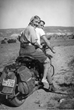 Georgia O'Keeffe Hitching a Ride to Abiquiu with Maurice Grosser, 1944. Maria Chabot, Photographic print