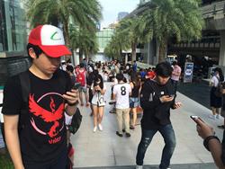 Pokemon GO players at Siam Paragon shopping mall in Bangkok