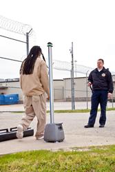 Inmate walking by CellsensePLUS unit
