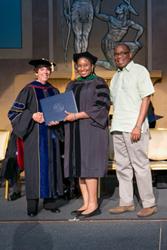 Trinity School of Medicine Dean Linda Adkison conveys diploma
