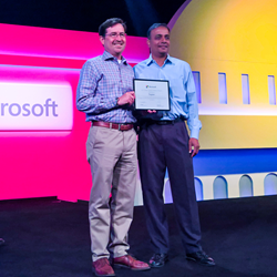 Sagitec Partner Ranjith Kotcherlakota (right) received the prestigious technology award at the annual Microsoft U.S. Public Sector Kickoff and Industry Solution University event on Aug. 9.