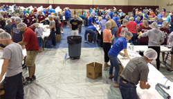 Volunteers pack meals for hungry children during Henderson Impact.