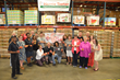 Staff at Second Harvest Food Bank of Metrolina shows off their donation of 18,000 pounds of peaches from Harris Teeter and Titan Farms