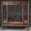 An Outstanding Chinese Zitan Carved Canopy Bed Realized $33,180.