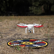 "Drone hovering over 32"" FlatHat Collapsible Drone Pad"