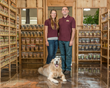 Gregg and Melissa Bernhardt, owners of Bag of Bones Barkery, pose with their Golden Retriever, Luke in the expanded store.