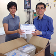 Vivienne Yong, a Malaysian physical therapist, and Dr. Heng Hock Sin unpacking Ambu Bags for the Coalition Duchenne Outreach Initiative in Kota Kinabalu