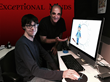 Exceptional Minds working studio now includes animation. Shown sitting is Exceptional Minds graduate Michael Yochim and instructor Howie Hoffman.
