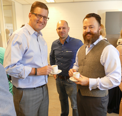 Michael Peveler, VP of Global Sales and Cory Cannon, President and COO of wePresent mingle with guests