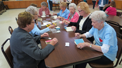 Volunteers from Elmwood United Methodist Church make greeting cards to be distributed to elderly residents as part of Celebrate. Serve. Impact.