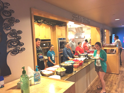 Empower Brokerage staff serving dinner at the Ronald McDonald House in Fort Worth, Texas