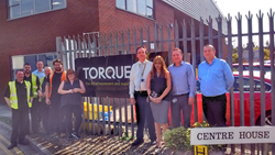 A team photo of members of our Heston team celebrating Torque's 25 year anniversary