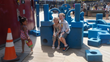 Caden and younger sister Bella in Imagination Playground Park.