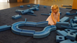 Bella Yocom enjoying the Big Blue Blocks at Brooklyn Children's Museum.