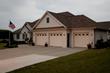 Insulated aluminum garage doors from Haas Door help keep home energy bills low.