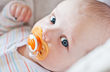 It consists of a bib with a pacifier ring sewn into a piece of fabric on the bib. It combines three essential items to help a baby not lose their pacifier. The pacifier is attached to the ring and the