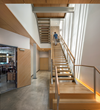 A grand open stair connecting the building's lobby to upper-floor office levels is a key interior feature of Arch11's design for the modern mixed-use commercial building (photo: Raul Garcia).