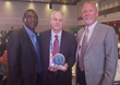 OSPA award winner David Aggleton (center) with IAPSC President Harold Gillens (left) and IAPSC member and OSPA finalist Pete Van Beek at the 2016 U.S. awards ceremony in Orlando.