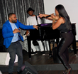 "Carlos Battey joins Aunyae Heart on stage while she performs. ""Excitement and joy I feel knowing that 'Deep End' is finally released for all of my fans to enjoy"".  - Aunyae Heart"