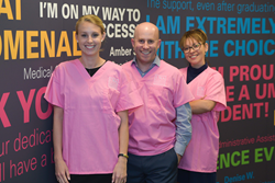 UMA staff in their pink scrubs from left to right: Hailey Wood, Dan Soschin and Erika Espitia