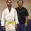 Edgar Cabachuela with Head Coach Sensei Butch after being awarded his Rokkyu - Yellow Belt