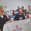Jive employees deliver donations to Refugee Action Network.