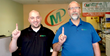 Minuteman Press franchise in Londonderry, NH celebrates 1 year in business. From left to right: Steve Hahn, Graphic Designer/Customer Service Rep.; and Robert Bean, Owner