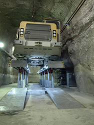 Stertil-Koni-installed parallelogram lift, operating thousands of feet below the surface was used to service special, heavy duty vehicles involved in a major mining operation.