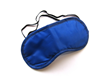 The Total Eye Mask is a dark eye mask that comes with earplugs connected to it with a plastic cable.