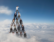 Pyramid of Humans in Clouds Photo Credit: By Blend Images – John Lund/Stephanie Roeser