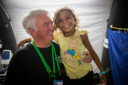 Don Stephens with a patient onboard the Africa Mercy