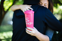 "Dutch Bros Coffee sells ""Be Aware"" travel mug to raise funds for Breast Cancer research."
