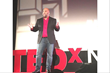 Mike Veny delivering a TEDx Talk on mental health and mental illness.