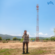 Man talking on mobile phone in Jharkhand, India, using BSNL's network Powered by VNL