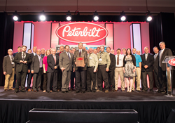 JX Peterbilt accepts Peterbilt Platinum Oval Award.