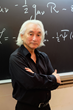 Dr. Kaku poses next to a chalkboard at the City College of New York.