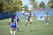 Jenna Hansen makes a leaping pass.