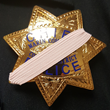 College of Marin police badge covered with pink mourning band